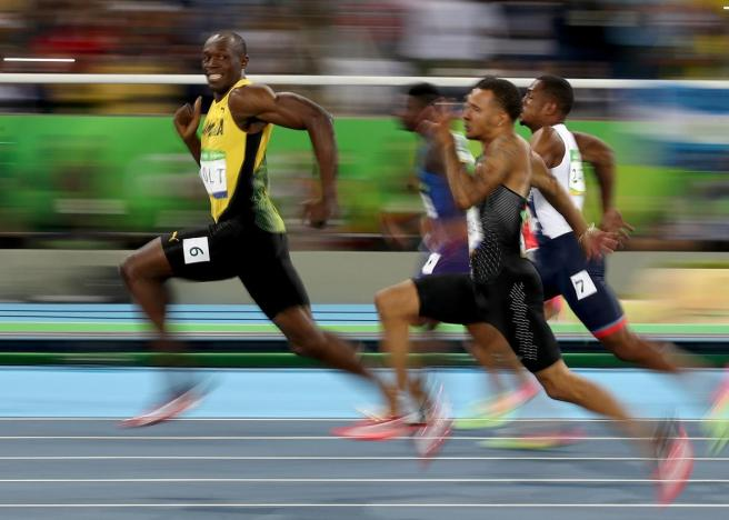 589521390-usain-bolt-of-jamaica-competes-in-the-mens-100-meter.jpg.CROP.promo-xlarge2